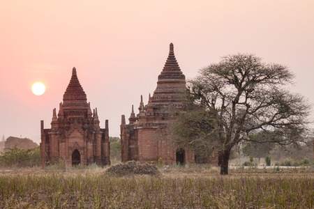 Ancient Buddhist temples at sunset in Bagan, Myanmar. The Bagan Archaeological Zone is a main draw for the countrys nascent tourism industry. Stock Photo