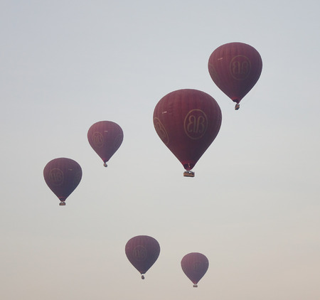 archaeological sites: Bagan, Myanmar - Feb 20, 2016. Hot air balloons flying in Bagan, Myanmar. Ballooning over Bagan is one of the most memorable action for tourists. Editorial