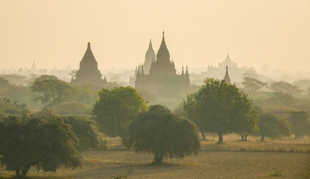 nascent: Ancient Buddhist temple at sunrise in Bagan, Myanmar. The Bagan Archaeological Zone is a main draw for the countrys nascent tourism industry.