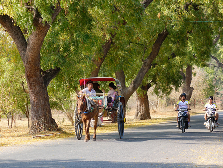 horse cart: Bagan, Myanmar - Feb 18, 2016. A horse cart running on the rural road in Bagan, Myanmar. Bagan in central Burma is one of the worlds greatest archeological sites.