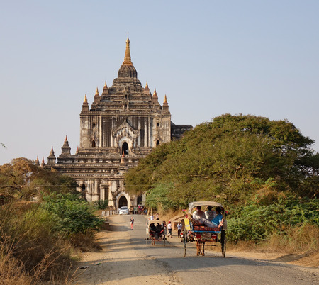 Bagan, Myanmar - Feb 18, 2016. Horse carts coming to Thatbyinnyu Temple in Bagan, Myanmar. Bagan is an ancient city and one of Asias most important archeological sites. Editorial