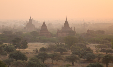 sight seeing: Ancient Buddhist temples at sunrise in Bagan, Myanmar. Bagan is an ancient city and one of Asias most important archeological sites.