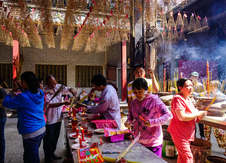 Saigon, Vietnam - Jan 30, 2017. Many people praying at Jade Emperor Temple located in Saigon, Vietnam. The temple is one of the five most important shrines in Saigon (Ho Chi Minh City).