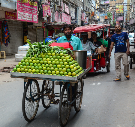 overcrowded: Delhi, India - Jul 26, 2015. A man selling fruits on street in Delhi, India. Delhi is the capital of India and the second most populated city in the country. Editorial