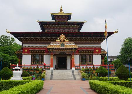 bodhgaya: Bodhgaya, India - July 22, 2015. Color paintings traditional Bhutanese Buddhist temple in Bodhgaya, India. Bodh Gaya is the most revered of all Buddhist sacred sites.