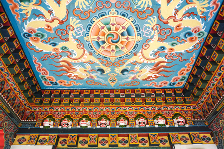 bodhgaya: Inside of the traditional Bhutanese Buddhist temple in Bodhgaya, India. Bodh Gaya is the most revered of all Buddhist sacred sites. Editorial