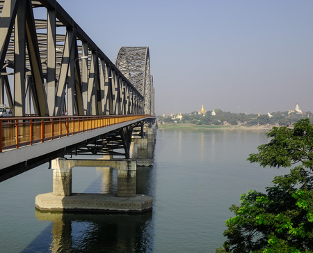 Steel bridge over the Irrawaddy river in Mandalay, Myanmar. Irrawaddy is the country largest river and most important commercial waterway.