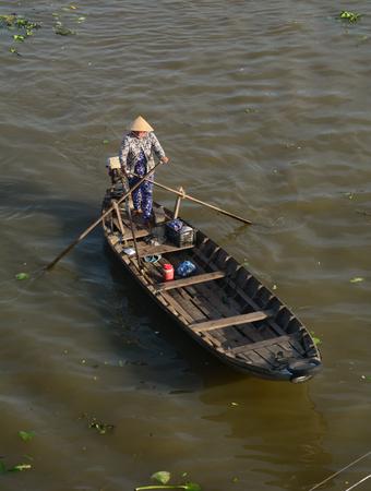 Soc Trang, Vietnam - Feb 2, 2016. A woman rowing boat at floating market in Soc Trang, southern Vietnam. The floating markets belong to the highlights of the Mekong delta, Vietnam.