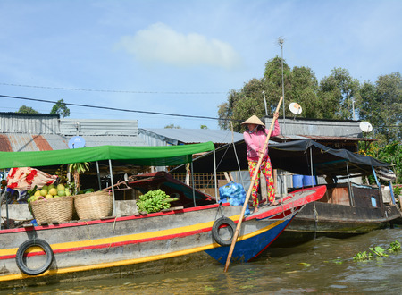 Soc Trang, Vietnam - Feb 2, 2016. People selling goods at the Nga Nam floating market in Soc Trang, Vietnam. The floating markets belong to the highlights of the Mekong delta, Vietnam.