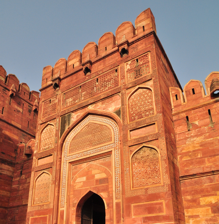 One of Main Gates of Agra Fort at the sunny day. The fort was built by the Mughals, can be more accurately described as a walled city in Agra, India. Editorial