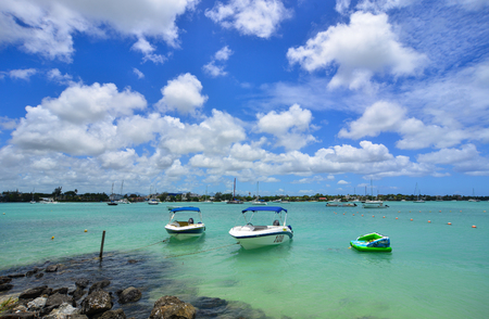 Grand Baie, Mauritius - Jan 10, 2017. Speedboats docking on the sea in Grand Baie, Mauritius. Mauritius is a major tourist destination, ranking 3rd in the region and 56th globally.
