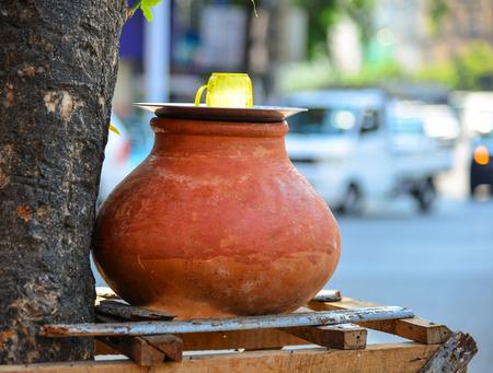 ollas de barro: Clay pot with water for drinking on street in Yangon, Myanmar.