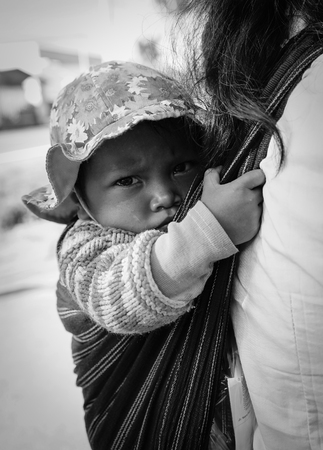 dalat: Dalat, Vietnam  - Dec 5, 2015. Portrait of Koho child at Tanung village in Dalat, Vietnam. Koho are an ethnic group living in the Dalat township of Central Highlands. Editorial
