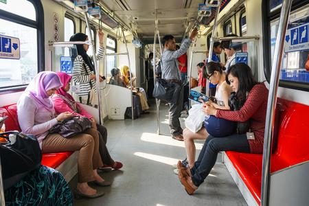 Kuala Lumpur, Malaysia - Jun 6, 2015. People on the LRt train in Kuala Lumpur, Malaysia. Rail transport in Kuala Lumpur encompasses the light metro (LRT) and monorail.