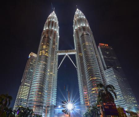 tallest bridge: Kuala Lumpur, Malaysia - Jun 6, 2015. Petronas Twin Towers at night in Kuala Lumpur (KL), Malaysia. KL is the cultural, financial and economic centre of Malaysia