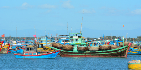 Binh Thuan, Vietnam - Jan 28, 2016. Wooden boats on the sea in Binh Thuan, Vietnam. Vietnam is a country with a coastline 3400 km long, with many beautiful coastal cities.