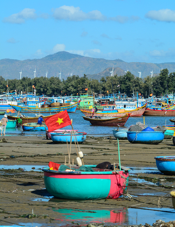 ne: Nha Trang, Vietnam - Jan 28, 2016. Bamboo basket boats on beach in Nha Trang, Vietnam. Vietnam is a country with a coastline 3400 km long, with many beautiful coastal cities.
