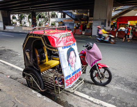 Manila, Philippines - Dec 20, 2015. A pedicab on street in Manila, Philippines. With 1,780,148 people in 2015, Manila is one of the most populous urban areas in the world.
