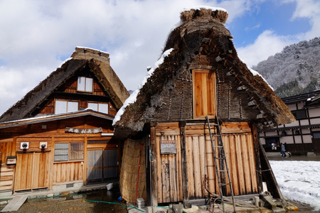 gifu: Gifu, Japan - Dec 29, 2015. Detail of wooden houses at Shirakawa-go village in Gifu, Japan. The village was registered as a UNESCO World Heritage Site in December 1995.