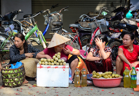 vietnamese ethnicity: Sapa, Vietnam - May 25, 2016. Local people at the street market in Sapa, Vietnam. Sapa is one of the main market towns in north-west Vietnam. Editorial