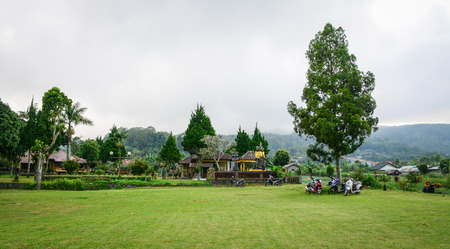 Bali, Indonesia - Apr 20, 2016. View of the park near Ulun Danu temple in Bali, Indonesia. Bali reported that it welcomed 2.88 million foreign tourists in 2012.