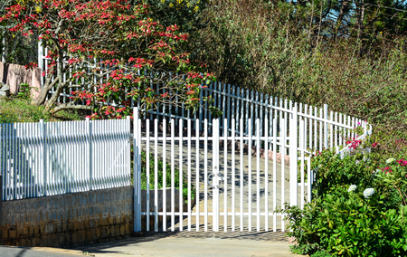 White picket fence with flowers at sunny day in the garden stock stock photo white picket fence with flowers at sunny day in the garden mightylinksfo