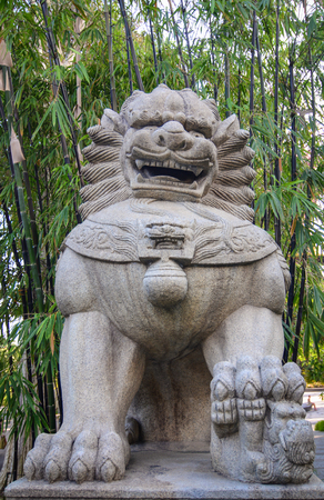 Singapore - Mar 12, 2016. A stone lion statue at the Gardens by the Bay in Singapore. Gardens by the Bay spans a total of 101 hectares of prime land at the heart of Singapore. Editorial