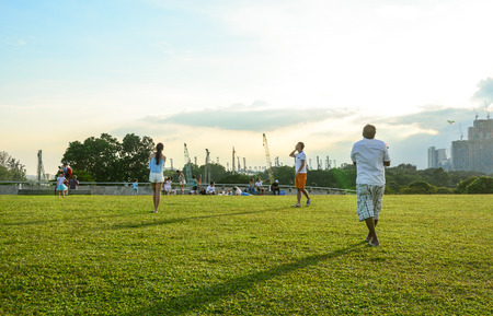 Singapore - Mar 12, 2016. People enjoy at the green park in Singapore. Singapore was ranked fourth in the 2014 Environmental Performance Index. Editorial