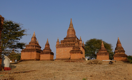 nascent: Ancient Buddhist temple at sunny day in Bagan, Myanmar. The Bagan Archaeological Zone is a main draw for the country nascent tourism industry. Stock Photo