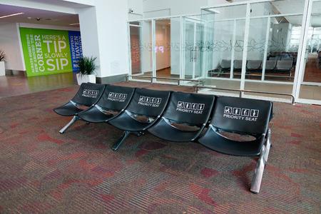 handled: Kuala Lumpur, Malaysia - Dec 16, 2015. Waiting chairs at the KLIA Airport in Kuala Lumpur, Malaysia. In 2015, KLIA handled 48,938,424 passengers and 726,230 tonnes of cargo. Editorial