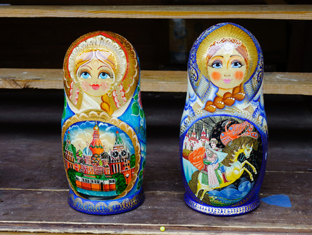 decreasing in size: Moscow, Russia - Oct 19, 2016. Matryoshka dolls for sale at Izmailovsky Market in Moscow, Russia. A matryoshka doll is a set of wooden dolls of decreasing size placed one inside another. Editorial