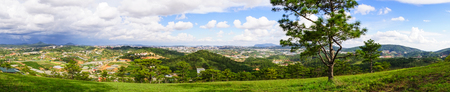 dalat: Panorama of Lang Biang Highlands in Dalat Highlands, Vietnam. Da Lat specific sights are pine wood with twisting roads and tree marigold blossom in the winter. Stock Photo