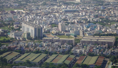 steadily: Yangon, Myanmar - Feb 14, 2017. Modern buildings rising in Yangon, Myanmar. The city area has steadily increased to 598.75 square kilometres in 2008.