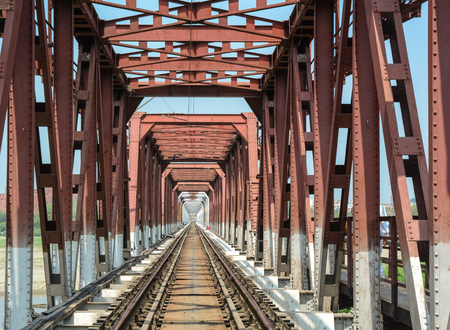 Old railway steel bridge at sunny day in Agra, India. Agra is a major tourist destination because of its many splendid Mughal-era buildings. Stock Photo