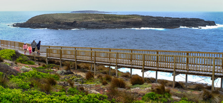 Adelaide, Australia - Apr 5, 2016. People walking on wooden bridge in Kangaroo Island, Australia. Kangaroo Island is Australia third-largest island, after Tasmania and Melville Island. Editorial