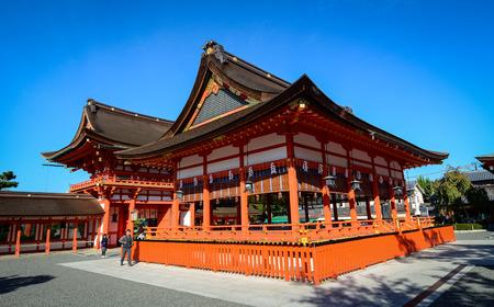 Kyoto, Japan - Oct 30, 2014. View of Fushimi Inari Taisha Shrine at sunny day in Kyoto, Japan. Fushimi Inari is the most important of shrines dedicated to Inari, the Shinto god of rice.