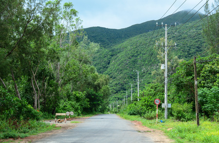 con dao: Rural road with the green forest in southern Vietnam.