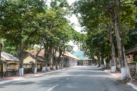 con dao: Rural road with many ancient prisons in Con Dao island, Vietnam. Stock Photo
