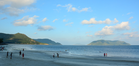 con dao: Con Dao, Vietnam - Sep 7, 2015. People playing on beach in Con Dao, Vietnam. The Con Dao Islands are an archipelago of Ba Ria Province, in the Southeast of Vietnam. Editorial