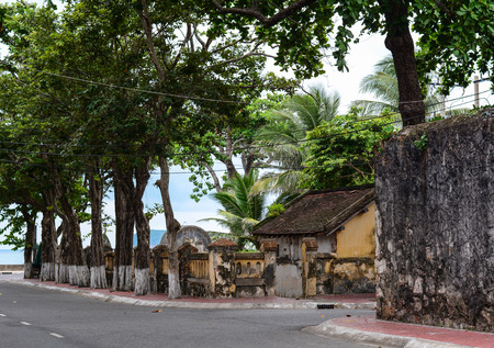 con dao: Old architecture of ancient prisons with many trees in Con Dao island, Vietnam. Stock Photo
