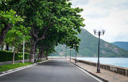 Rural road with many lamp post in Con Dao island, Vietnam.