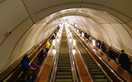 Saint Petersburg, Russia - Oct 11, 2016. People on escalator at underground metro station in Saint Petersburg, Russia. St Petersburg is Russia second-largest city after Moscow, with 5 million inhabitants