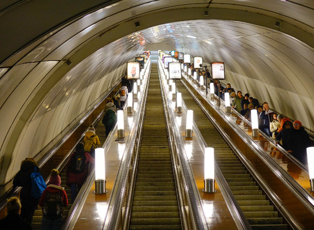traction: Saint Petersburg, Russia - Oct 11, 2016. People on escalator at underground metro station in Saint Petersburg, Russia. St Petersburg is Russia second-largest city after Moscow, with 5 million inhabitants