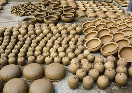 Pottery products in Hoi An, Vietnam. They used clay to shape by hand out flower pots.
