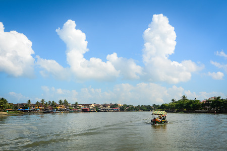 Hoi An, Vietnam - Dec 3, 2015. A motorboat runs on the Hoai river in Hoi An ancient town, Vietnam. Hoi an is recognized as a World Heritage Site by UNESCO.