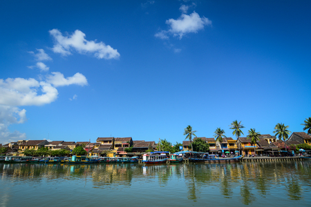 Hoi An, Vietnam - Dec 3, 2015. River scenery with Hoi An ancient town in Quang Nam, Vietnam. Hoi an is recognized as a World Heritage Site by UNESCO. Editorial