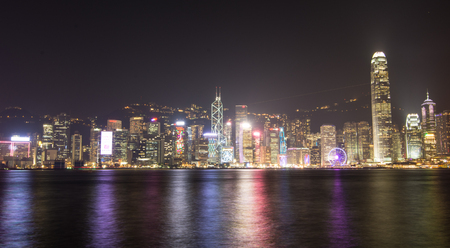 characterised: Hong Kong - Dec 27, 2014. Cityscape of Hong Kong at night. Hong Kong has a major capitalist service economy characterised by low taxation and free trade.