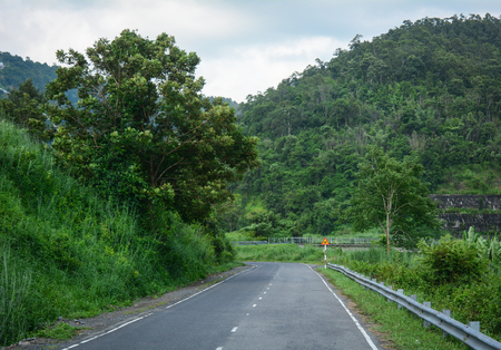 Mountain road in Central Highlands of Vietnam. Central Highlands (Tay Nguyen) is a plateau bordering the lower part of Laos and northeastern Cambodia. Stock Photo