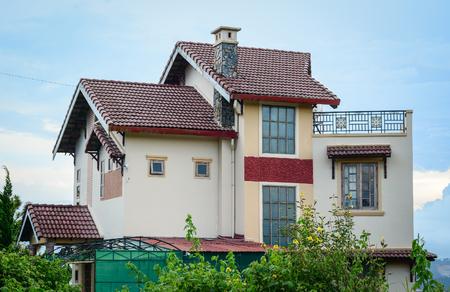 above 21: Dalat, Vietnam - Sep 21, 2015. A modern villa located on the hill in Dalat, Vietnam. Da Lat is located 1,500 m above sea level on the Langbian Plateau.