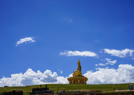 Sichuan, China - Aug 18, 2016. Big Buddha on the grass hill in Garze Tibetan, Sichuan, China. Tibetan Buddhism is historically the predominant religion practiced in Garze.